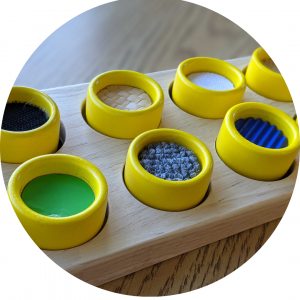 Picture of several yellow cups with different textured material inside